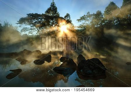 background blur light morning with the mist of the hot springs covered. Is a popular place to visit in the morning in Thailand.