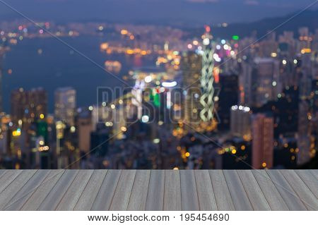 Opening wooden floor Hong Kong city night light blurred bokeh central business downtown abstract background