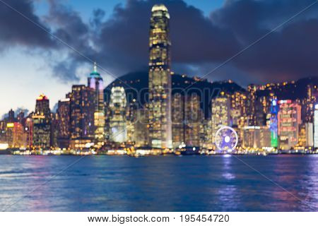 Twilight blurred bokeh sea front office building downtown Hong Kong abstract background