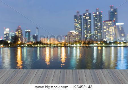 Opening wooden floor City office building with water reflection light abstract background