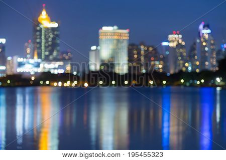 Night reflection blurred bokeh offcee building light at twilight abstract background