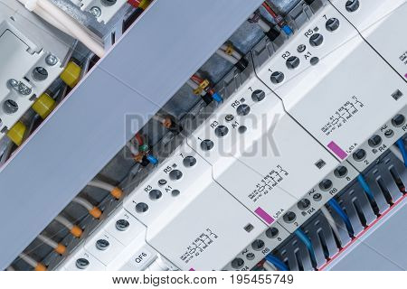 In the electrical Cabinet are mounted circuit-breakers modular contactors. Automatic switches modular contactors arranged in a row. The wires are laid and hid in the perforated cable channel.