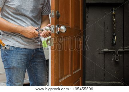 locksmith open the wood door to see another lock for home - can use to display or montage on product