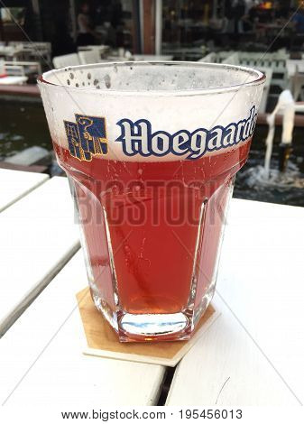 BANGKOK THAILAND - 15 JULY 2017: Hoegaarden draft Belgium beer in large size glass on the table
