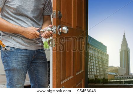 locksmith open the wood door by cylinder tools to cityscape - can use to display or montage on product