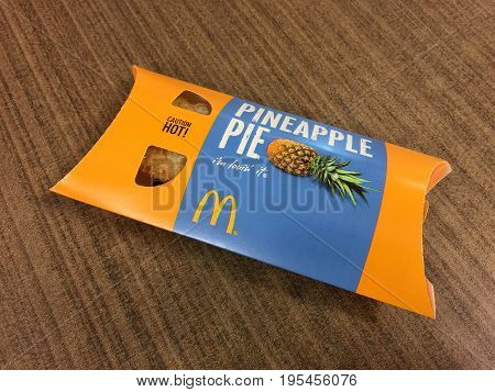 BANGKOK THAILAND 15 JULY 2017: A McDonald's Pineapple Pie on the table. McDonald's is the world's largest fast food .