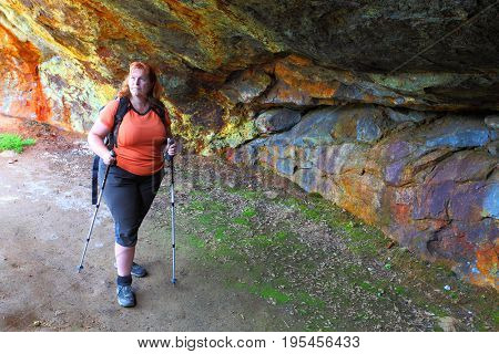 Hiker woman explore ancient underground mine for metallic ore mining near Bodenmais in Bavaria, Germany.