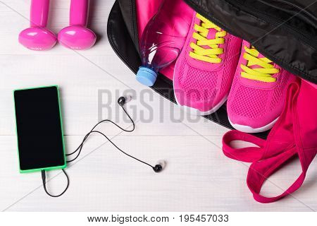 Beautiful sports concept on a gray board from a set for sports in a bag and music for sports
