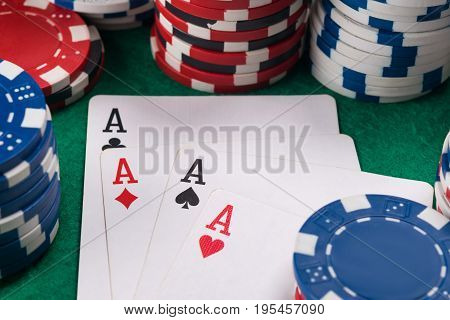 Four aces in cards for poker luck for a poker player on a casino table