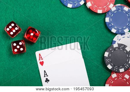 Beautiful concept on a poker table of dice and cards and poker chips