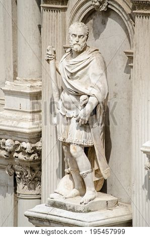Statue of Francesco Maria I della Rovere Duke of Urbino on the exterior of the Doge's Palace in Venice Italy. The former soldier was sculpted in 1587 by Giovanni Bandini wearing a Roman uniform with an imperial eagle handle on his sword.