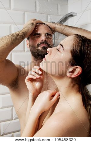 Young couple taking shower.