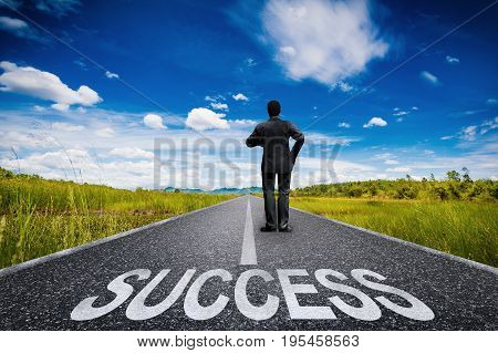 success concept with 3d rendering businessman standing on long road