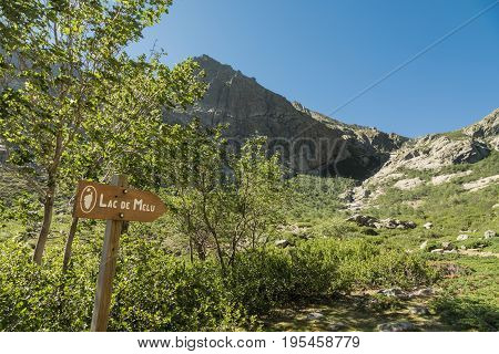 Wooden Sign For Lac De Melu In Mountains Ofcorsica