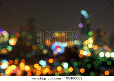 Background blur bokeh from the lights of buildings and cars on the streets of the capital during the night. Colorful beautiful in Bangkok Thailand.