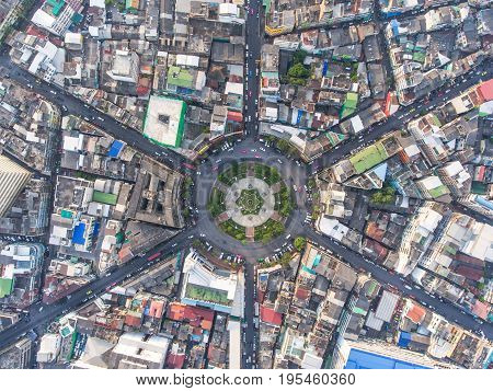 Aerial view Road roundabout with car lots in the city in Thailand.Sixth Street intersection is beautiful.cityscape.Light evening.