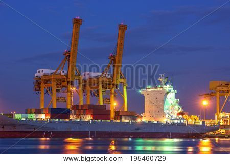 container ship in import export and business logistic.By crane Trade Port Shipping.Tugboat assisting cargo to harbor.Aerial view.Light during twilight sky.
