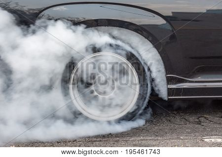 Dragster Car Burn Out Rear Tyre With Smoke .
