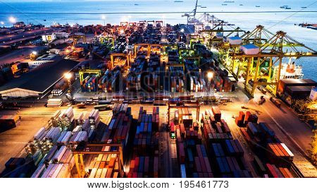 container ship in import export and business logistic.By crane Trade Port Shipping.cargo to harbor.Aerial view.Top view.Near Dark to Light the Night.