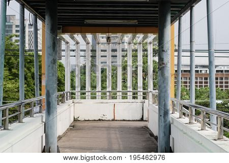 Structure of footbridge sooting photo on overpass.