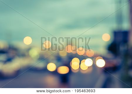 vintage tone image of blur car on road in evening for background usage.(horizontal)