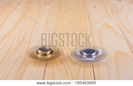 Hand With Spinner On Table.
