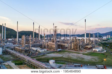 Aerial view Oil refinery with a background of mountains and sky.The factory is located in the middle of nature and no emissions. The area around the air pure.