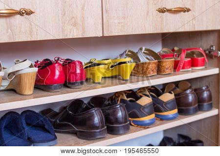 Women's and men's shoes in the closet