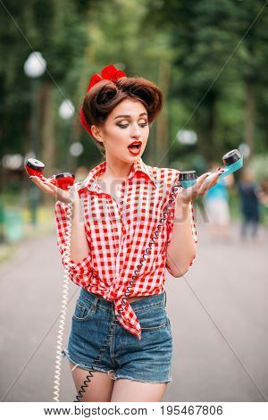 Glamour pin up girl with retro rotary telephones