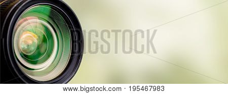 Camera lens with lense reflections. Light background.