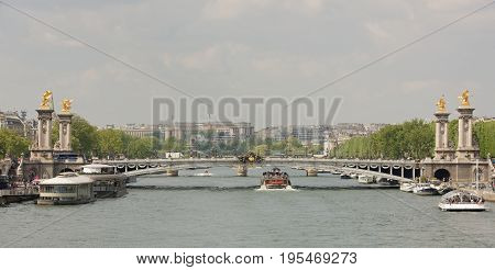 ParisFrance- April 29 2017: View of the Alexander lll Bridge . By the embankments are moving cars and pedestrians