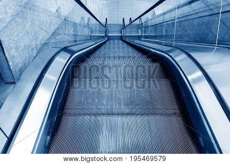 Airport terminal escalator modern building interior Shanghai China.