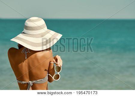 Sexy Back Of A Beautiful Woman In Bikini, Creative Hat And Sunglasses On Sea Background. Retro Vinta
