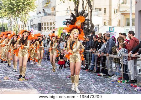 LIMASSOL, CYPRUS - FEBRUARY 26: Happy people in teams dressed with colorfull costumes at famous Limassol Carnival Parade, February 26, 2017 in Limassol.