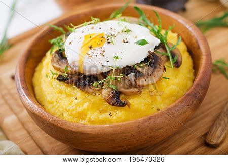 Breakfast. Polenta With Mushrooms And Poached Egg