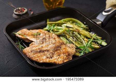 Turkey- Chicken Fillet Cooked On A Grill And Garnish Of Green Beans.