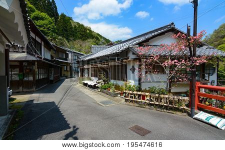KYOTO, JAPAN - APRIL 19, 2016 - Shops in the small village of Sagakiyotakicho line the street leading to Mount Atago