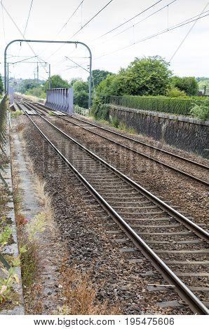 Railway lines crossing over a metal bridge in Redon France
