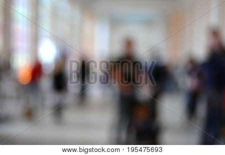 Many people Inside the building. Blurred background. Bokeh. Copy spase space for text.