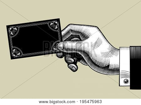Hand with a visiting card. Vintage engraving stylized drawing