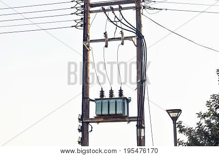 View of Voltage power transformer on electricity post