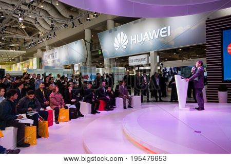 HANNOVER GERMANY - MARCH 14 2016: Presentation of Huawei product line president Jeff Wang in booth of Huawei company at CeBIT information technology trade show in Hannover Germany on March 14 2016
