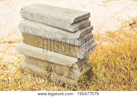 Small Concrete blocks on the grass outdoors