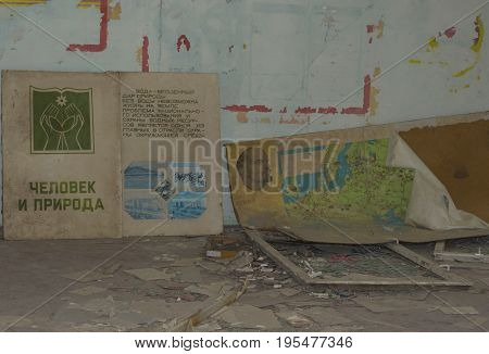 PRIPYAT UKRAINE - JUNE 25 2017: Abandoned Room In Ghost Town of Chernobyl Within Chernobyl Alienation Zone. Text on book