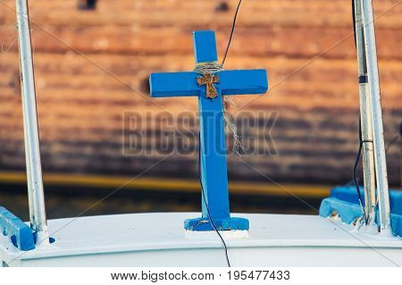 Blue wood cross. Religious and spiritual concept.