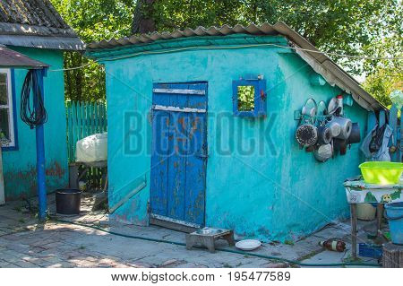 Entrance to home cellar in Russian village at summer time