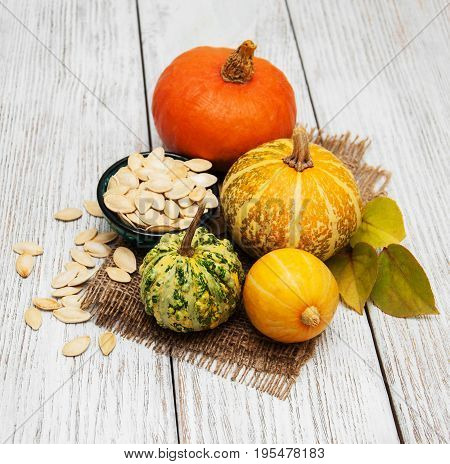 Pumpkins And Bowl With Seeds