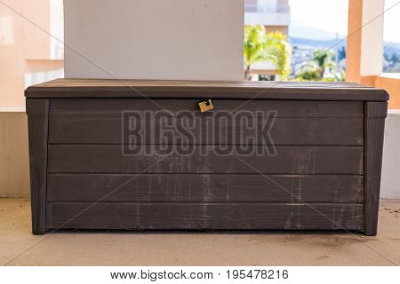 Old wooden brown chest with closed lid