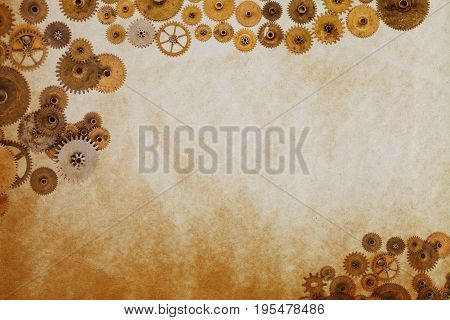 Industrial machinery template, cogs gears on aged textured paper manuscript. Steampunk ornament vintage paper sheet.