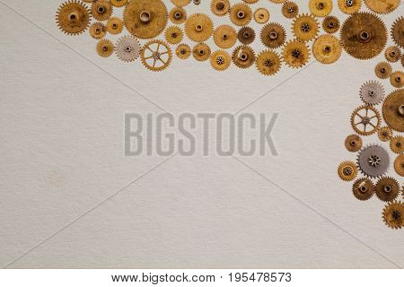 Vintage manuscript industrial machinery design template. Aged cogs gears clockwork parts on white textured paper background, copy space.